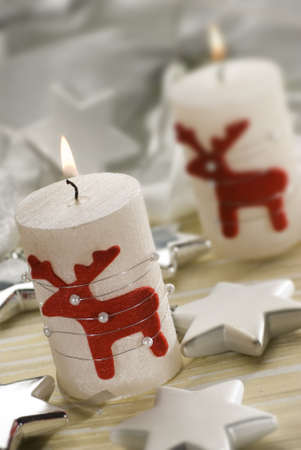 moos: christmas candles with small figures close up Stock Photo