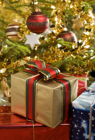 christmas tree purple: christmas gifts under christmas tree close up Stock Photo