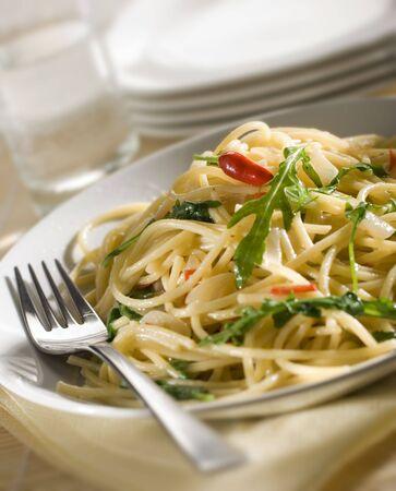 bolognaise: Spaghetti dish with chili and rocket close up shoot Stock Photo