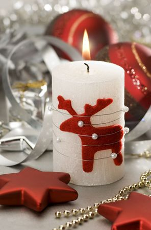 moos: christmas candle with small figure close up Stock Photo