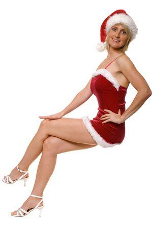 sexy xmas elf: sexy santa girl sitting isolated on white Stock Photo
