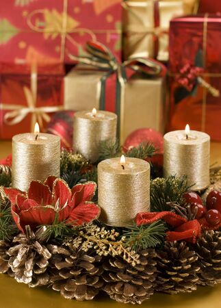 advent candles: advent wreath with golden candles close up shoot