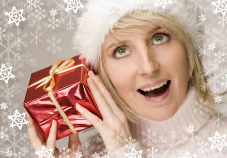 young santa girl with red present close up shoot Stock Photo