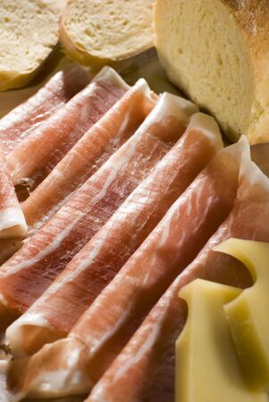 fresh prosciutto with cheese and bread close up shoot photo