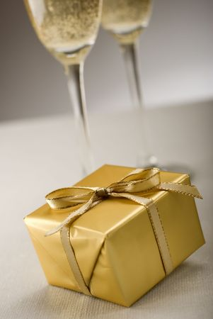 golden gift with champagne in background close up Stock Photo - 2335385