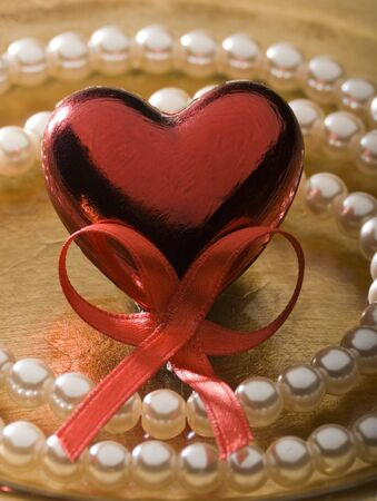 valentine - red heart and pearl necklace close up photo