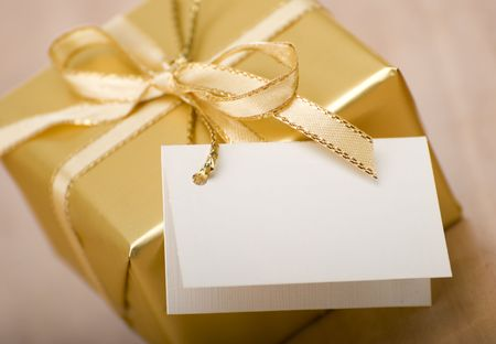golden gift box with empty card close up shoot Stock Photo - 2361754