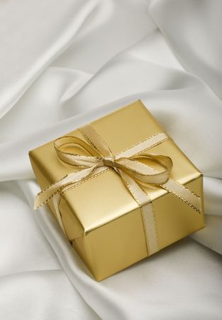 golden present with a note on silver silk close up Stock Photo - 2373628