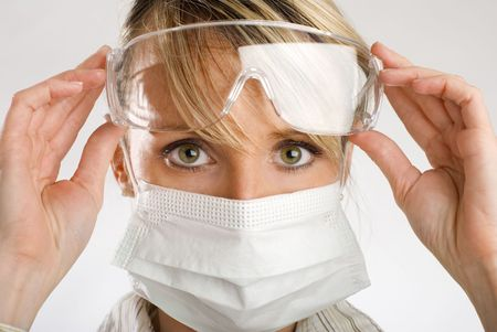 young female doctor with mask and glasses close up photo