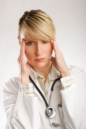 young beautiful woman doctor in stress portrait photo