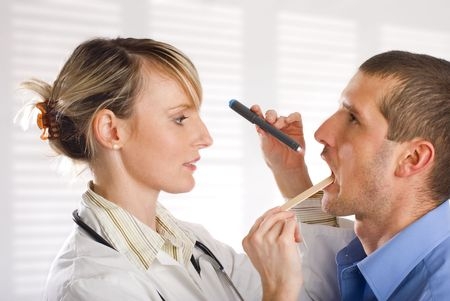 young female doctor looking at patient portrait photo