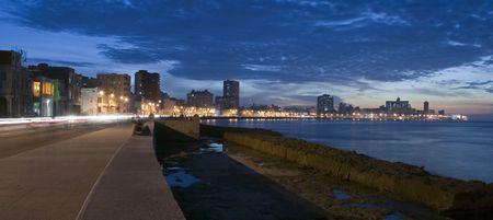 seafronts: malecon night street scene in havana - cuba