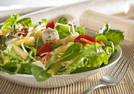 green salad: fresh colorful salad with cheese close up shoot