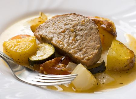 seasoned: roasted turkey meat with potatoes and vegetables