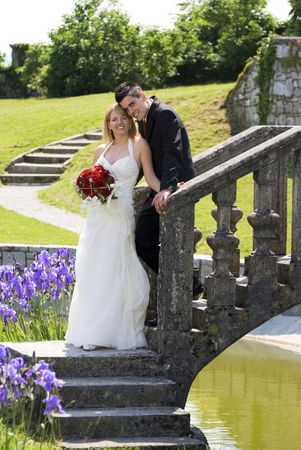 A bride and groom standing outside portrait