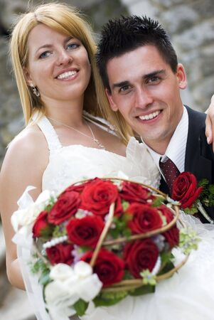 young couple on the wedding day portrait photo