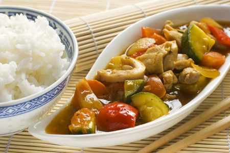 asian chop suey with chicken and rice close up photo