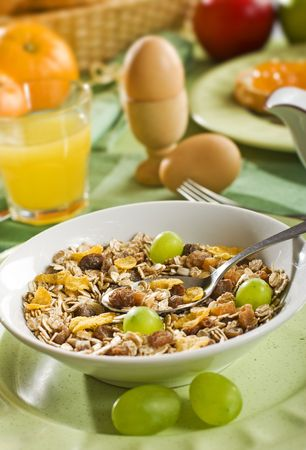 corn flakes with muesli grapes and raisins close up photo