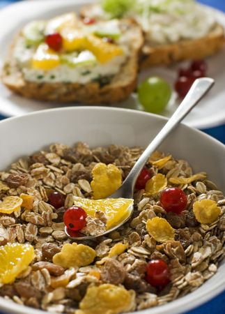 corn flakes and muesli with fruit breakfast close up photo