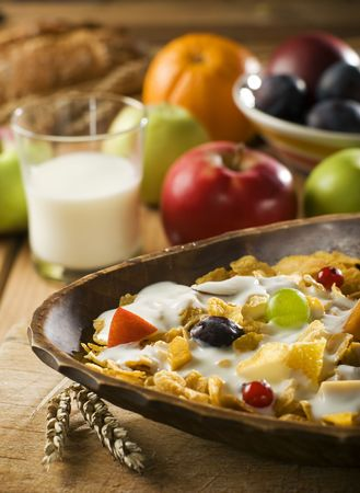 corn flakes with milk and fruit close up photo