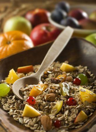 muesli with sliced fresh fruits close up photo