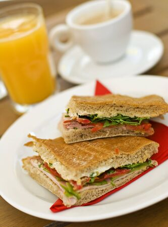 sandwich with ham tomato and salad close up photo