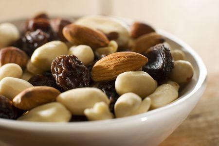 mixed nuts with raisins close up shoot photo