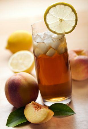 peach and lemon ice tea with ice close up