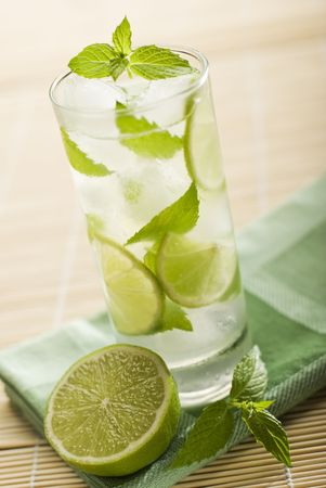 fresh mojito with lime and mint close up photo