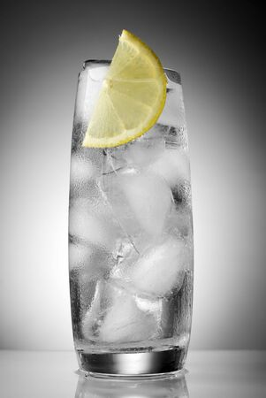 mineral water with ice and lemon close up photo