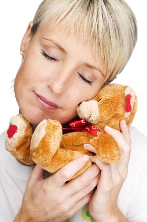 young blond girl with teddy bear close up photo