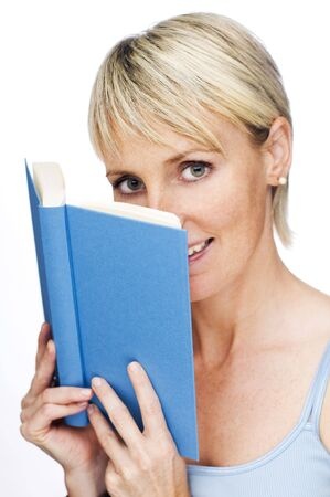 curios: young blond woman holding blue book close up