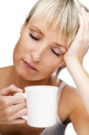 young blond woman with cup of coffee early in the morning Stock Photo - 3493994