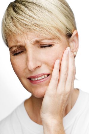 dent douleur: jeune femme blonde dans la douleur de pr�s tournage  Banque d'images