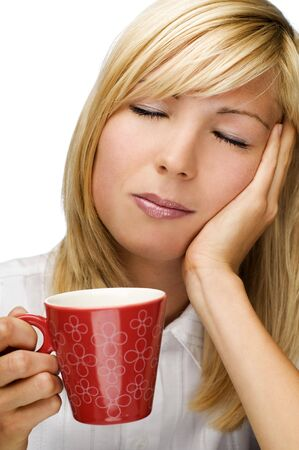 young blond woman with cup of coffee early in the morning Stock Photo - 3690605