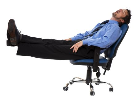 asleep chair: young business men sleeping in a chair isolated on white
