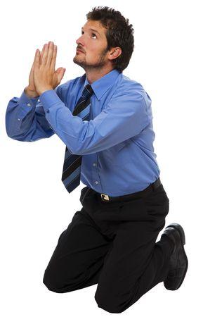 man praying: young Business man on his knees praying Stock Photo