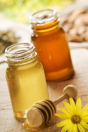 honey pot: honey in two jars close up shoot