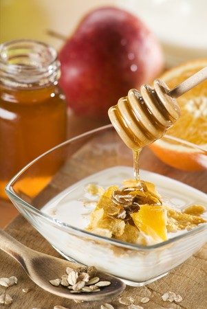 mixed nuts: muesli with milk honey and fruit close up Stock Photo