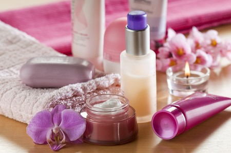Cream, soap towels and orchid close up photo