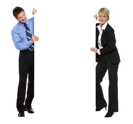 advert: young business couple holding empty advert sign Stock Photo