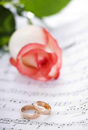 sheetmusic: wedding rings on note sheet close up shoot