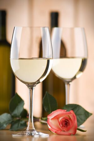 glass of white wine with rose close up shoot photo