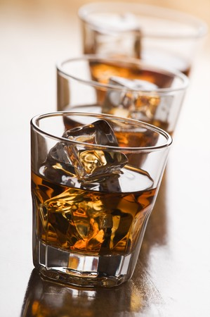 glass of whiskey with ice close up shoot photo