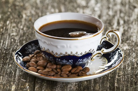 fresh cup of coffee on wood close up photo