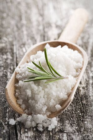 sea salt with rosemary on a wooden spoon Stock Photo - 4441264