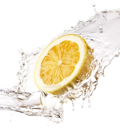 splash of water on lemon close up shoot