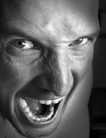 demented: very angry mens face close up shoot Stock Photo