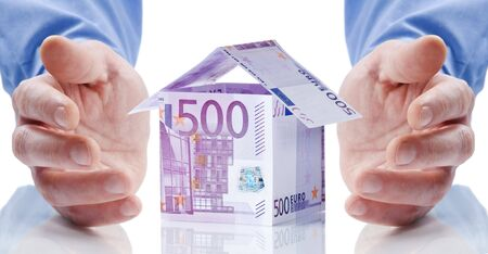 housing prices: House made of money isolated on white background