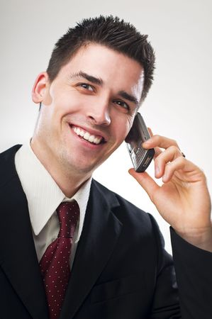 young business man talking on mobile phone Stock Photo - 4634827